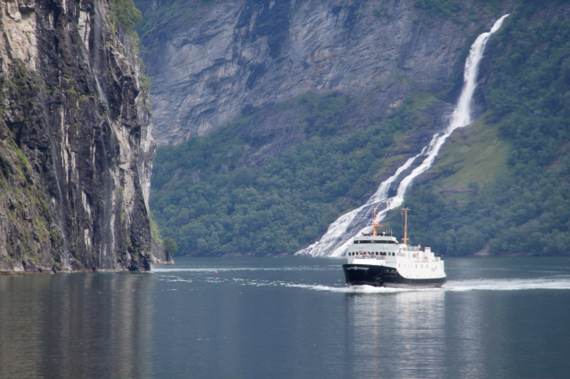 A five level ferry boat pales in comparison to the towering fjord cliffs, like a toy boat such is the scale and magnitude of the surrounding landscape